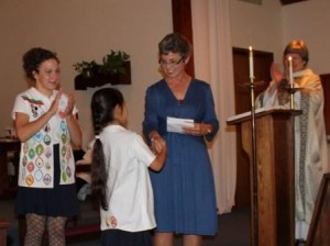 Awards being given at Sunday morning service.